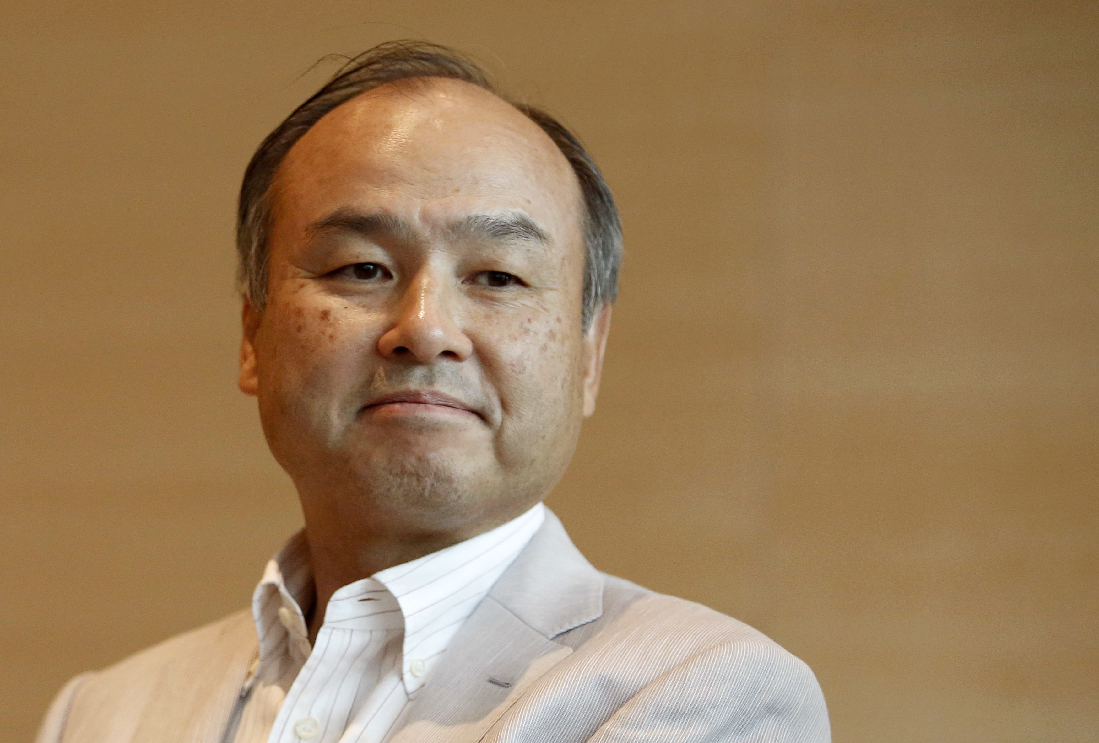 SoftBank Corp. Chief Executive Masayoshi Son attends a roundtable discussion with journalists at its headquarters in Tokyo, in this June 17, 2014 file photo. SoftBank, Japan's third-largest mobile operator, is an aggressive acquirer that last year bought No.3 U.S. wireless company Sprint Corp, and is in talks to buy fourth-ranked T-Mobile US Inc. It is also a significant shareholder in Chinese e-commerce giant Alibaba Group, and has stakes in mobile game companies Supercell and Gungho Online Entertainment Inc. It plans to amass 5,000 companies within its empire by 2040, up from nearly 900 now. REUTERS/Yuya Shino/Files (JAPAN - Tags: BUSINESS TELECOMS)